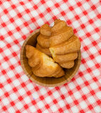 Croissants on the checked picnic blanked. Croissants in the bowl on the checked picnic blanked Stock Photo