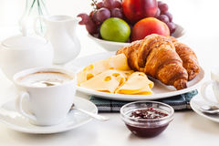 Croissants with cheese, fruits and coffee Royalty Free Stock Photo