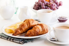 Croissants with cheese, fruits and coffee Royalty Free Stock Images