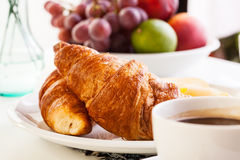 Croissants with cheese, fruits and coffee Royalty Free Stock Photography