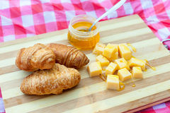 Croissants with cheese and honey Royalty Free Stock Image