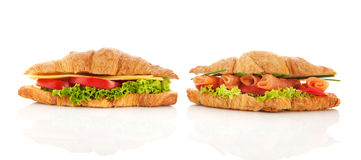 Croissants with cheese, salmon and vegetables Royalty Free Stock Images