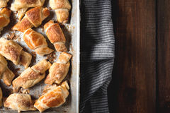 Croissants with chocolate on baking tray. Baking with croissants fresh from the oven Stock Photo