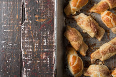 Croissants with chocolate on baking tray. Warm, crispy croissants on a baking fresh from the oven Stock Image