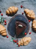 croissants with chocolate, cake and hips Stock Photography