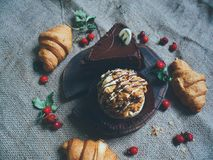 croissants with chocolate, cake and hips Royalty Free Stock Photos
