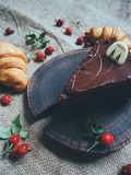 croissants with chocolate, cake and hips Stock Images