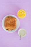 Croissants with chocolate filling on a white plate Royalty Free Stock Images