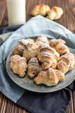 Croissants with chocolate filling on a wooden background Stock Images