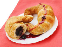 croissants with chocolate and raspberry jam on p Royalty Free Stock Images