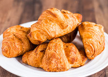 Croissants with chocolate on a white plate, breakfast Royalty Free Stock Photo