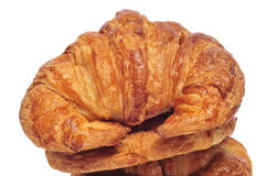 Croissants. Closeup of some croissants on a white background stock image