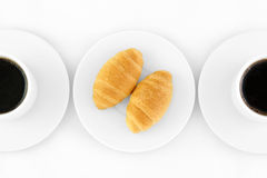 Croissants and Coffee. Top down view of two coffee cups and croissants Stock Photography