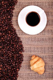 Croissants coffee and beans on the table Stock Photo