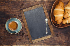Croissants and coffee with blackboard Stock Image