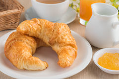 Croissants with coffee cup and fruit jam Royalty Free Stock Photos