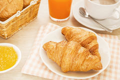 Croissants, coffee cup and juice on table, filtered image Stock Image