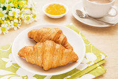 Croissants and coffee cup on table, filtered image Stock Photo