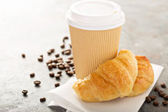 Croissants with coffee to go. In a paper cup, take away breakfast Stock Photography