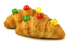 Croissants with colorful conserved fruits Royalty Free Stock Images