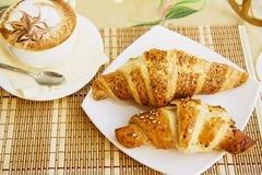 Croissants and cup of cappucino Royalty Free Stock Photos