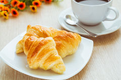 Croissants and cup of coffee Royalty Free Stock Photo