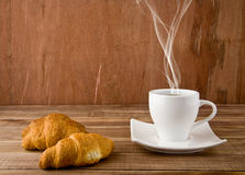 Croissants and cup of coffee Royalty Free Stock Image