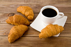 Croissants and cup of coffee Stock Photos