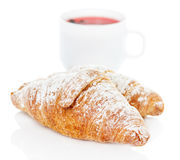 Croissants and cup of tea Royalty Free Stock Images