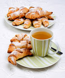 Croissants with cup of tea. Stock Image
