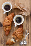 Croissants with cups Stock Photography