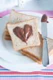 Croissants de petit déjeuner de dimanche avec le beurre de thé et d'arachide Photo libre de droits