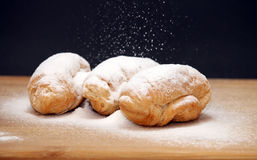 Croissants. Delicious croissants with powdered sugar Stock Images