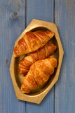 Croissants in dish on blue background Royalty Free Stock Photos