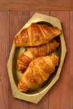 Croissants in dish on brown background Royalty Free Stock Photography
