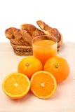 Croissants e sumo de laranja Fotos de Stock