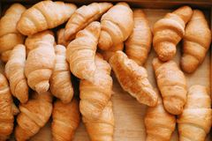 Croissants. French croissants lying in display for sale stock photos