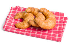 Croissants frescos em guardanapo checkered Fotos de Stock