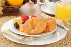 Croissants and fresh fruit Stock Photography