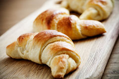 Croissants. Fresh homemade croissants on wooden table, selective focus Royalty Free Stock Photography