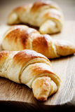Croissants. Fresh homemade croissants on wooden table, selective focus Stock Photography