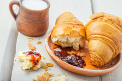Croissants with fruit jam and milk Stock Photo