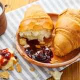 Croissants with fruit jam and milk Stock Photography
