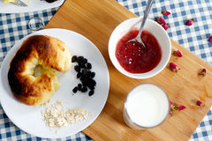 Croissants with glass of milk and jam Royalty Free Stock Photography