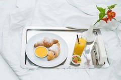Croissants with honey and orange juice stock photos
