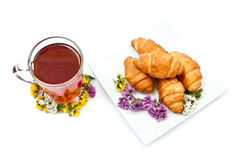 Croissants and hot tea Stock Images