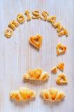 Croissants i listy ciasto na stole Obraz Royalty Free