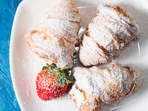 Croissants with icing sugar Stock Image