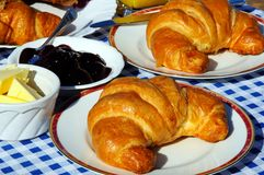 Croissants with jam and butter. Royalty Free Stock Photo