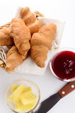Croissants, jam and butter Royalty Free Stock Photo